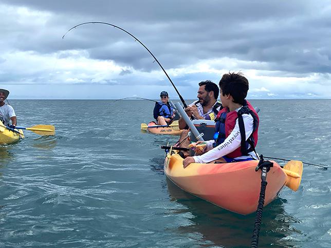 Family kayak fishing in Rincon, Puerto Rico.